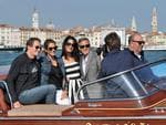 George Clooney, third right, his fiancee Amal Alamuddin, Cindy Crawford and her husband Rande Gerber cruise past St. Mark's Square as they arrive in Venice, Italy on Friday, September 26th 2014. Picture: AP