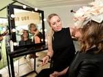 Carly O'Sullivan gets her make up touched up by Cas De Bruin from Stella and Hutch in the Cotton On marquee.