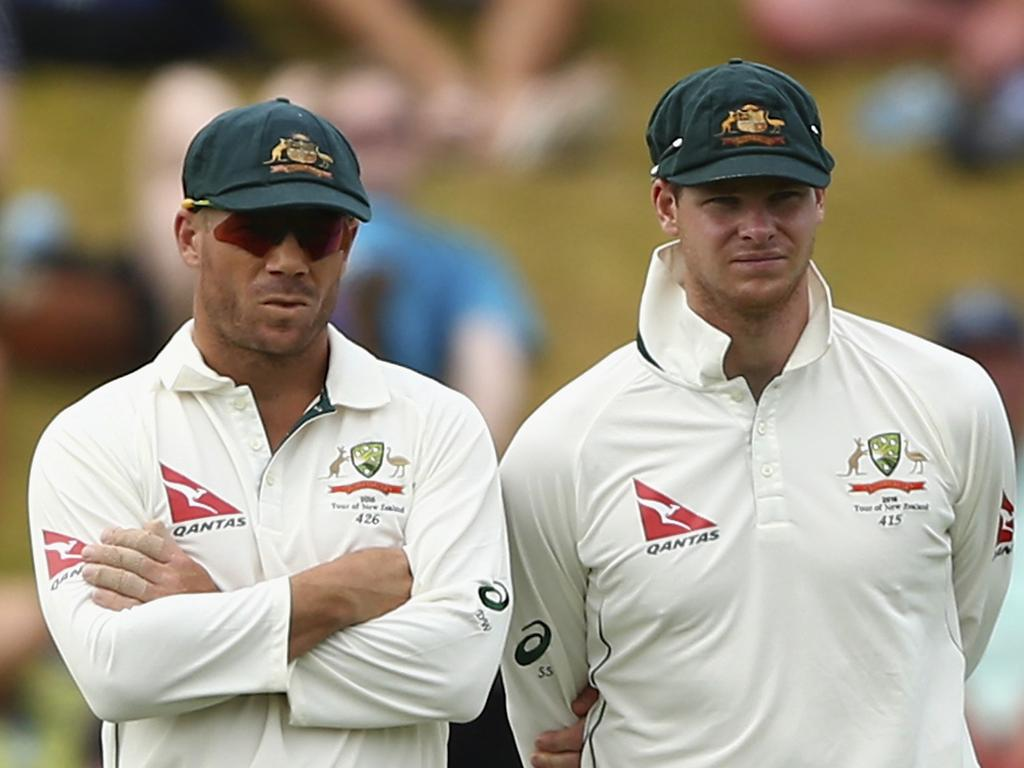 WELLINGTON, NEW ZEALAND - FEBRUARY 15: David Warner of Australia speaks with Steve Smith of Australia during day four of the Test match between New Zealand and Australia at Basin Reserve on February 15, 2016 in Wellington, New Zealand. (Photo by Ryan Pierse/Getty Images)