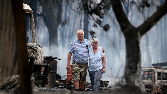Mr and Mrs Campbell take in what is left of their life. Picture: Nathan Edwards