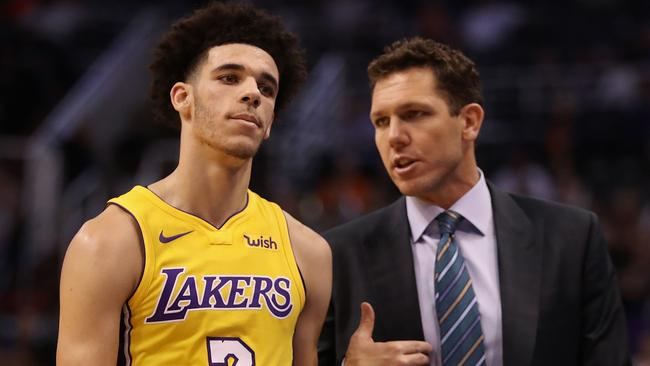 Lonzo Ball of the Los Angeles Lakers talks with head coach Luke Walton.