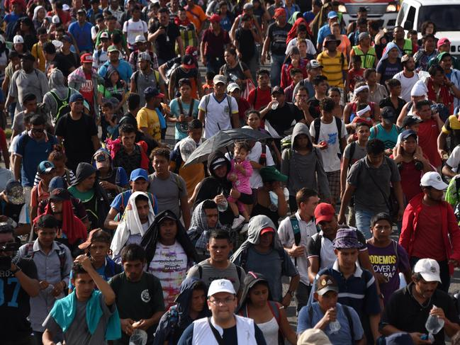 Thousands of Central American migrants are marching towards the US border in search of a better life. Picture: Johan Ordonez / AFP