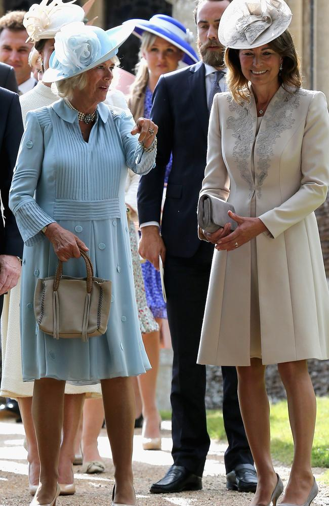 Into the blue ... Camilla, Duchess of Cornwall, in pale blue, and Carole Middleton in ivory. Picture: Getty Images