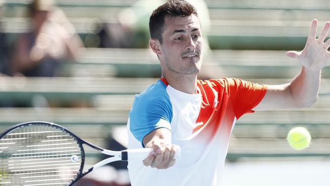 Bernard Tomic played singles and mixed doubles at Kooyong on Tuesday.