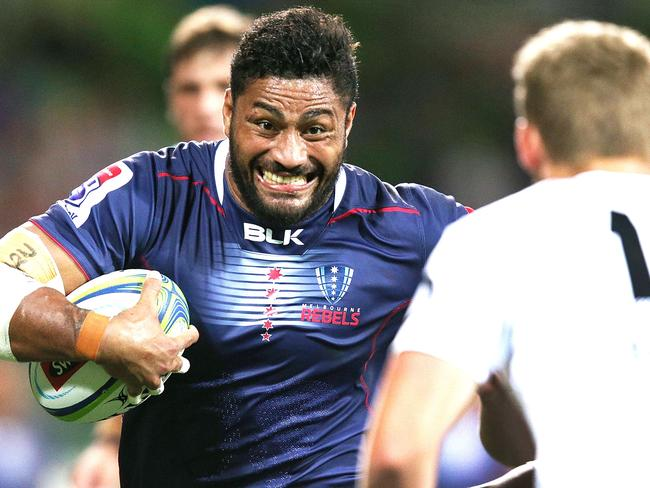 The Rebels' Amanaki Mafi charges at the Sharks defence on Friday night.