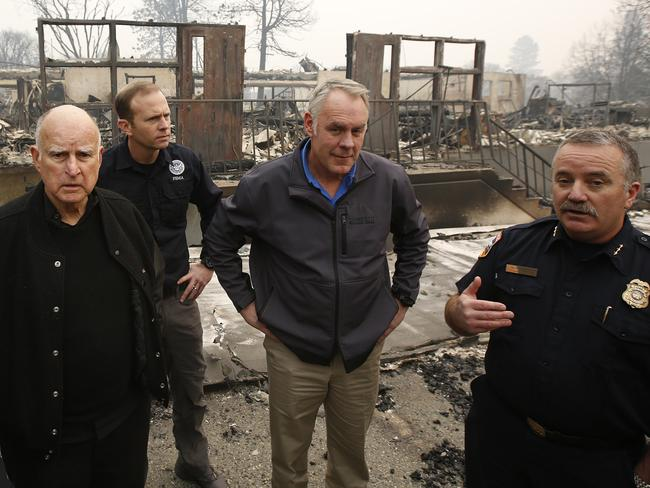 (from left) California Gov. Jerry Brown, FEMA Director Brock Long, US Secretary of the Interior Ryan Zinke, Scott Upton, forestry and fire protection chief, survey the damage. Picture: AP