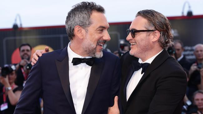 Joaquin Phoenix and Director Todd Phillips walk the red carpet ahead of the screening. Picture: Getty.