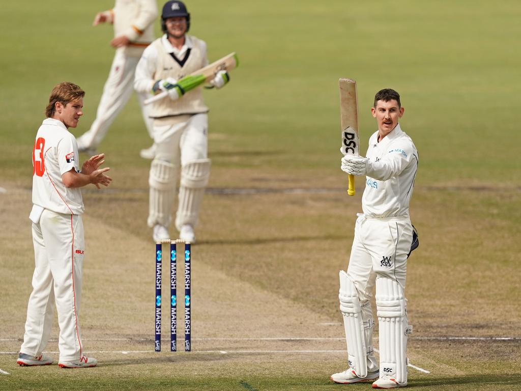 Nic Maddinson of Victoria celebrates after reaching his double century as batsman Will Pucovski of Victoria and bowler Adam Zampa applaud.