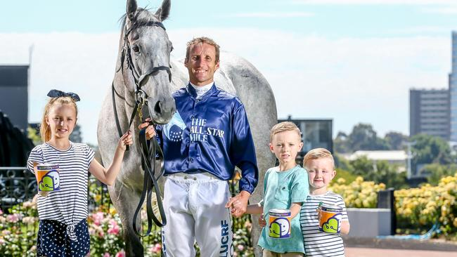 Jockey Damien Oliver with clerk-of-the-course horse Archie and Mia, 10, Jack, 7, and Flynn, 4. Picture: Tim Carrafa