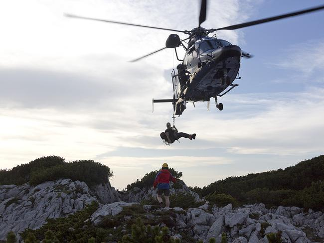 Help is here ... rescue workers arrive by helicopter near the entrance to the Riesending underground cave.