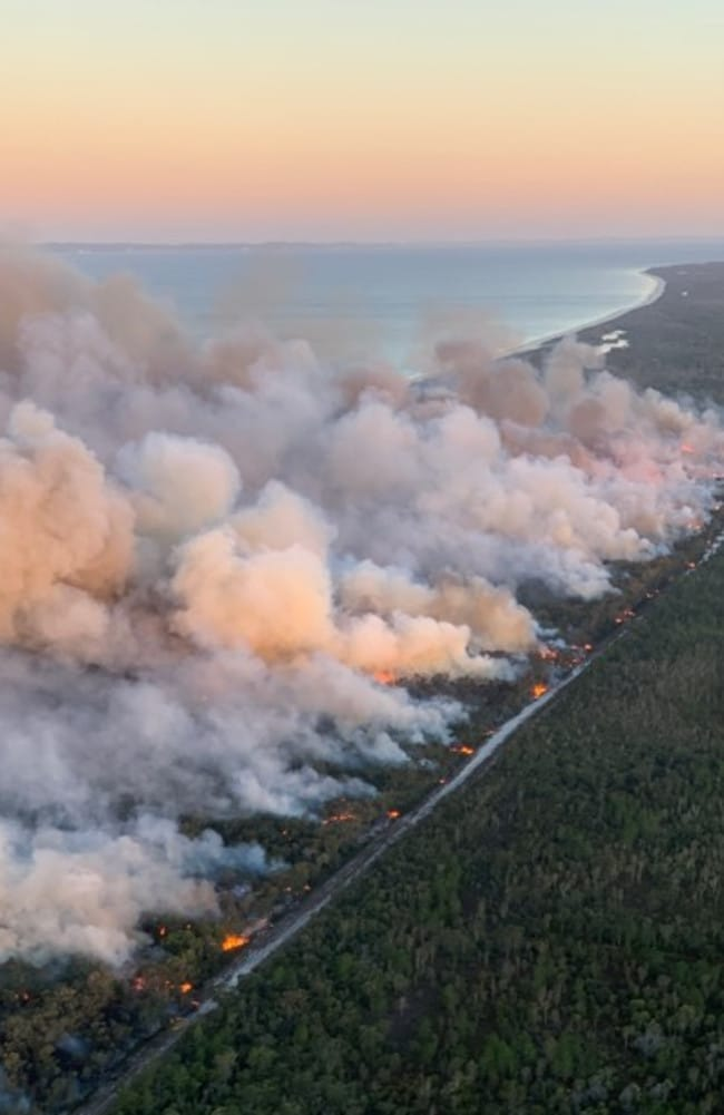 Bushfires on the northern end of Bribie Island, which engulfed campsites on Wednesday, are continuing to blanket the Sunshine Coast in smoke.