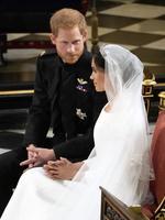 Britain's Prince Harry and Meghan Markle during their wedding at St. George's Chapel in Windsor Castle in Windsor, near London, England, Saturday, May 19, 2018. Credit: Owen Humphreys/pool photo via AP