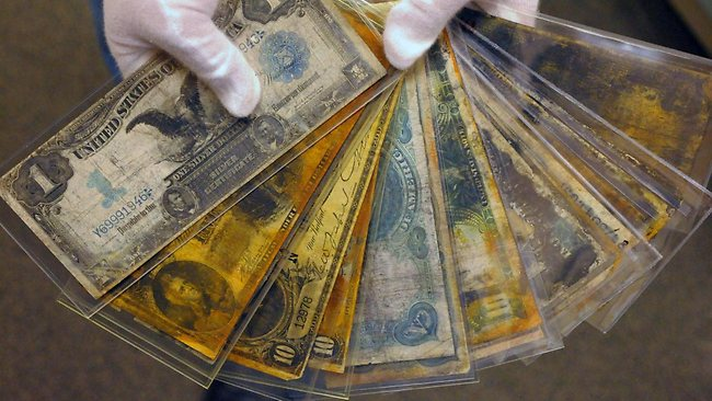 Currency, part of the artefacts collection of the Titanic that will be put up for auction in April. Picture: AP