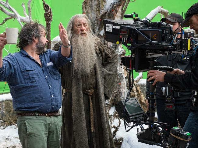 Jackson (left) on  <i>The Hobbit</i> set with actor Ian McKellen, who played the wizard Gandalf.