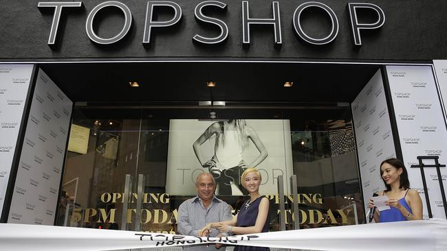 Sir Philip Green made Topshop world famous, here opening a store in Hong Kong, but also chaired its parent company as the chain sunk to a $1bn loss. Picture: Jessica Hromas/Getty