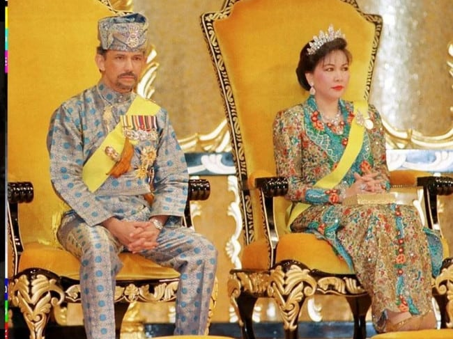 Sultan Hassanal Bolkia and second wife Queen Hajah Mariam sit on the throne during an investiture ceremony for the Sultan's 50th birthday celebrations.