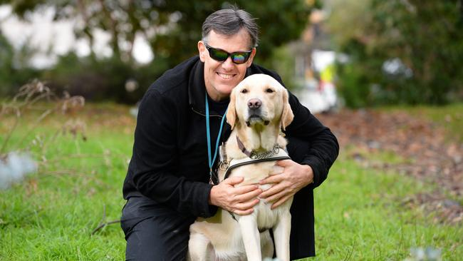 Simon and his guide dog Khan are taking part in Dialogue in the Dark. Picture: Lawrence Pinder