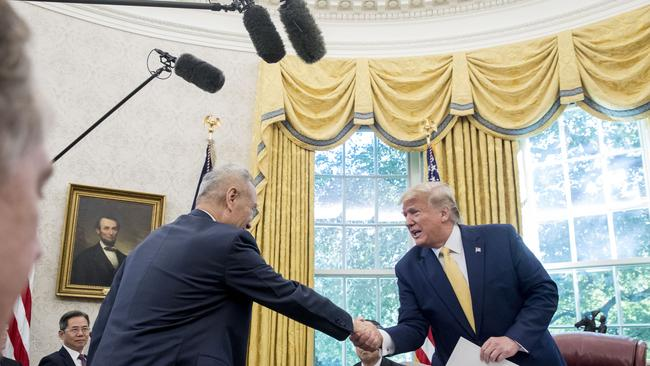 President Donald Trump shakes hands with Chinese Vice Premier Liu He in the Oval Office of the White House. Picture: AP
