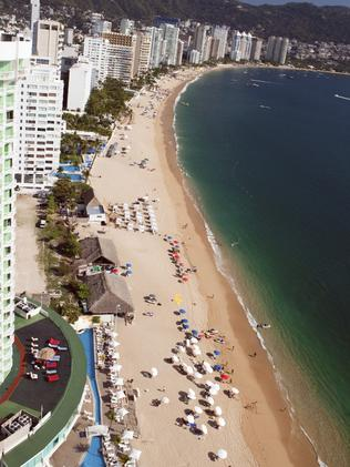 Acapulco beach is dotted with hotels, apartments and is popular with holiday-makers.