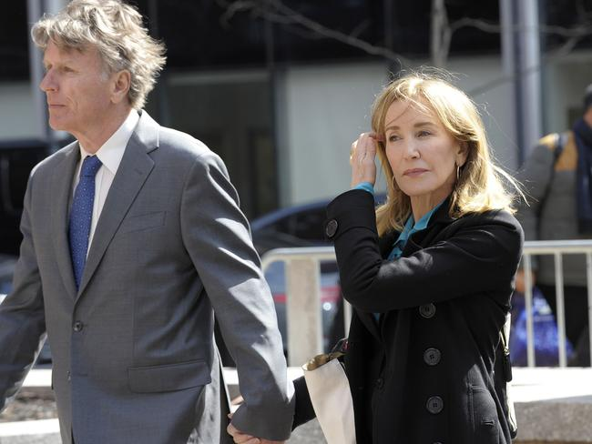 Actress Felicity Huffman enters court in Boston with her brother. Picture: AFP