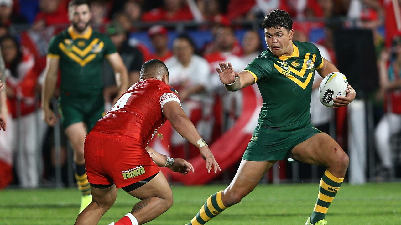 Latrell Mitchell of Australia (right) is challenged by Siliva Havili of Tonga during the Rugby League Test match between the Australia Kangaroos and the Tonga Mate Ma'a in Auckland, October last year.