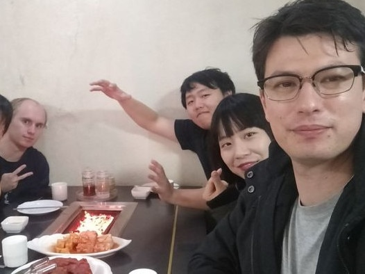 Alek Sigley and his wife Yuka (far right) with friends in Pyongyang. Picture: Twitter
