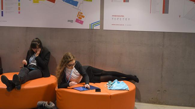 Participants take some rest before the end of the final session of the COP24 summit on climate change in Katowice, Poland. Picture: AFP