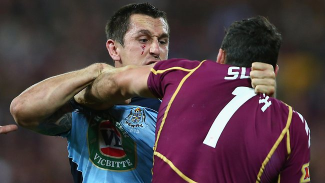 Mitchell Pearce squares up to Billy Slater after the Queenslander landed an elbow on his face.