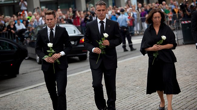 Norway's Prime Minister Jens Stoltenberg, center, his wife Ingrid Schulerud, right, and the leader of the Workers' Youth League (AUF), Eskil Pedersen, left, pay tribute to victims of the twin attacks before a memorial service at Oslo Cathedral. Picture: Emilio Morenatti / AP