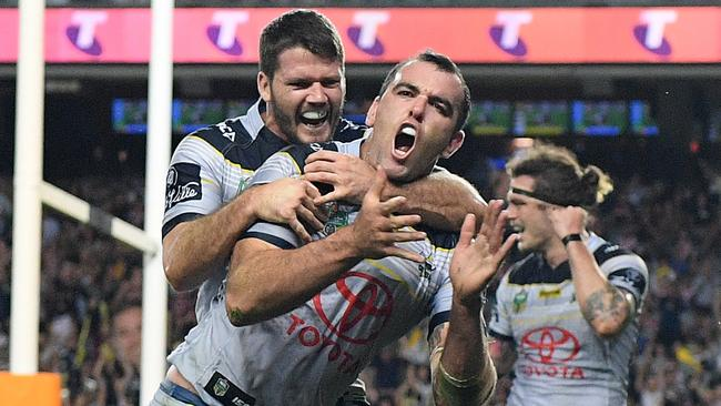 Kane Linnett of the Cowboys celebrates with Lachlan Coote.