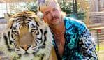 "This undated photo courtesy of Netflix shows Joseph ""Joe Exotic"" Maldonado-Passage with one of his tigers. - Amid a constant swirl of grim coronavirus news, the surreal tale of a gay, mullet-wearing private zookeeper who calls himself ""Joe Exotic"" -- now in prison for murder-for-hire -- has captivated a nation stuck on the couch. ""Tiger King: Murder, Mayhem and Madness"" -- featuring a menagerie of big cats, wacky employees and misfit lovers -- is part ""Animal Planet"" and part ""Breaking Bad."" And it's all true. (Photo by - / Netflix US / AFP) / RESTRICTED TO EDITORIAL USE - MANDATORY CREDIT ""AFP PHOTO / NETFLIX"" - NO MARKETING - NO ADVERTISING CAMPAIGNS - DISTRIBUTED AS A SERVICE TO CLIENTS / TO GO WITH AFP STORY by Paul HANDLEY, ""'Tiger King': true-crime tale of 'Joe Exotic' grips shut-in nation"""