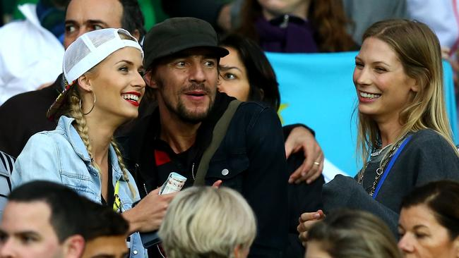 Lena Gercke (L), girlfriend of Sami Khedira of Germany, and Sarah Brandner, girlfriend of Bastian Schweinsteiger of Germany, (R) seem to be enjoying the occasion.