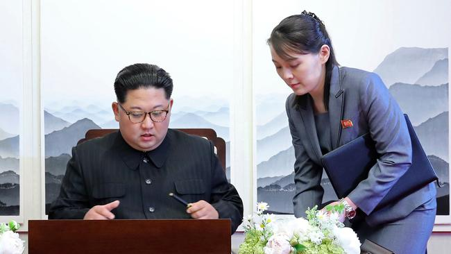 Kim Jong Un signs a guest book next to his sister Kim Yo Jong, seen as a possible successor. Picture: AP