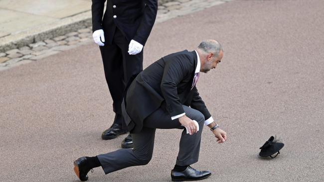 We have a runaway hat! SECURE THE PALACE GATES! Picture: AP