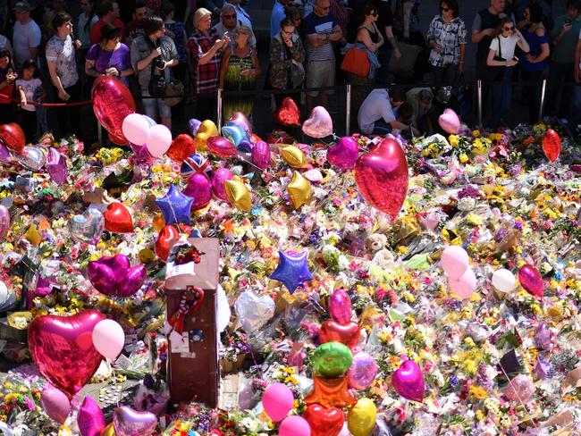 A carpet of messages of support and floral tributes to the victims of the Manchester attack in St Ann's Square in Manchester on May 27. Picture: AFP