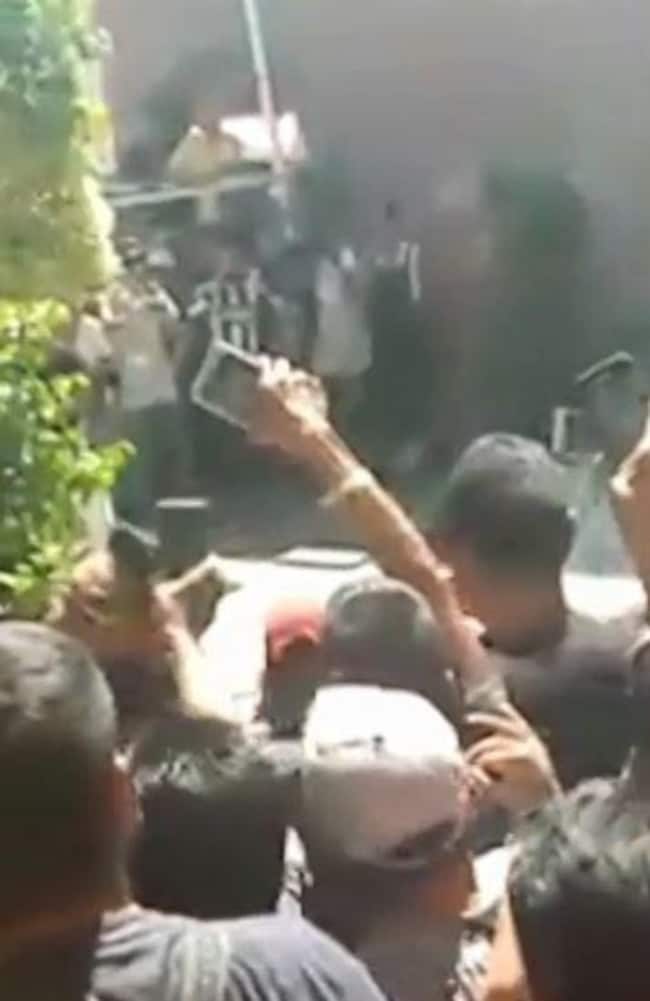 The mob filmed the brutal attack on their phones. Picture: Televisia.news