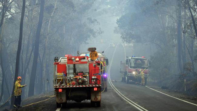 This photo taken on December 18, 2019 shows firefighters making arrangements to secure the residential area from an approaching bushfire in Dargan, some 120 kilometres from Sydney. Picture: Saeed Khan / AFP