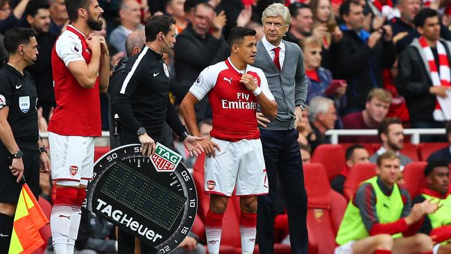 Alexis Sanchez of Arsenal waits to come on.