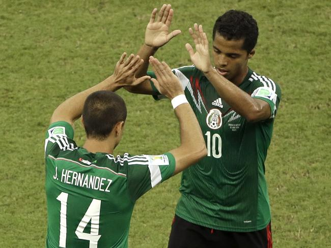 Mexico's players celebrate a job well done against Croatia.
