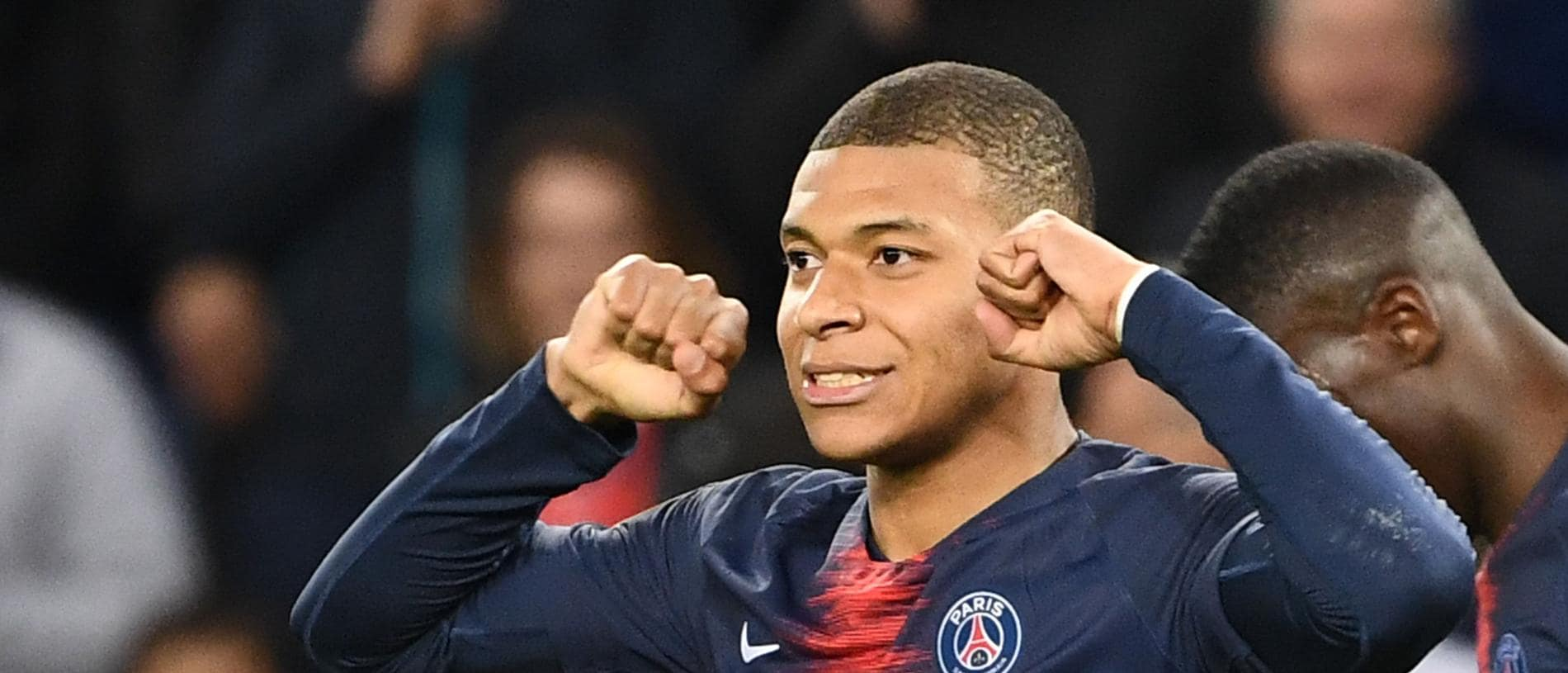 Paris Saint-Germain's French forward Kylian Mbappe celebrates scoring his team's third goal during the French L1 football match between Paris Saint-Germain and Nimes at the Parc de Princes in Paris on 23 February 2019. (Photo by FRANCK FIFE / AFP)