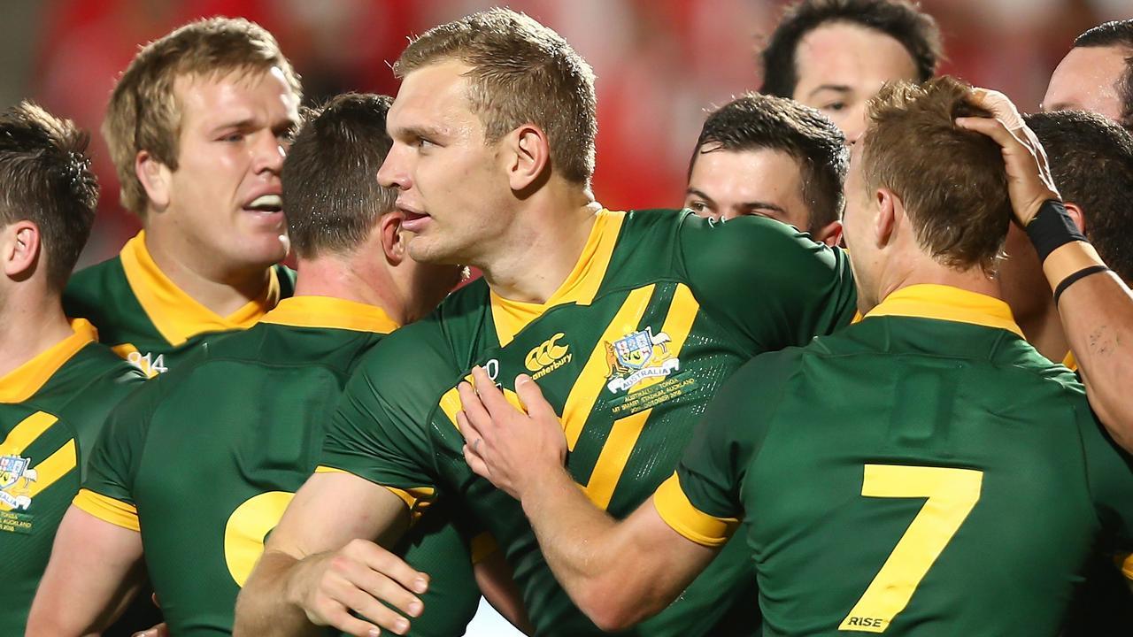 Tom Trbojevic of Australia (centre) celebrates with teammates.