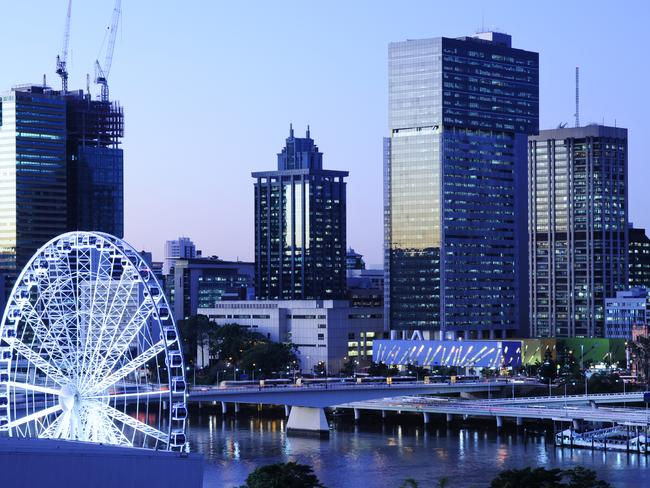 Brisbane CBD with the Brisbane Eye in the forground overlooking the river, shot from South Bank