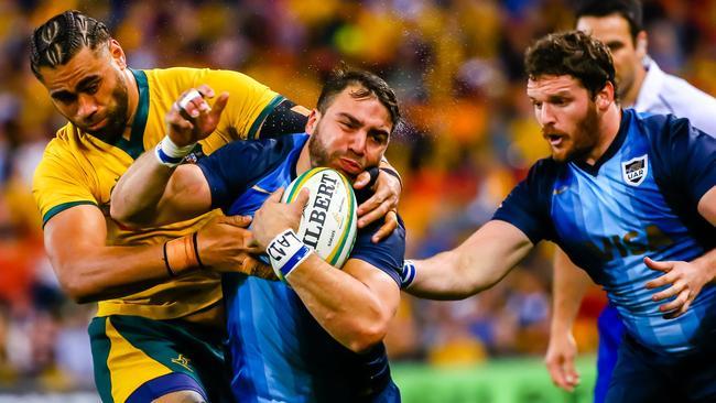 Australia's Lukhan Salakai-Loto tackles Argentina's Facundo Isa.
