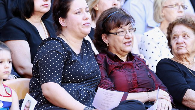 Ross Livermore's daughter Helen Douthit and wife Merelda Livermore attend the service. Picture: Jonathon Searle
