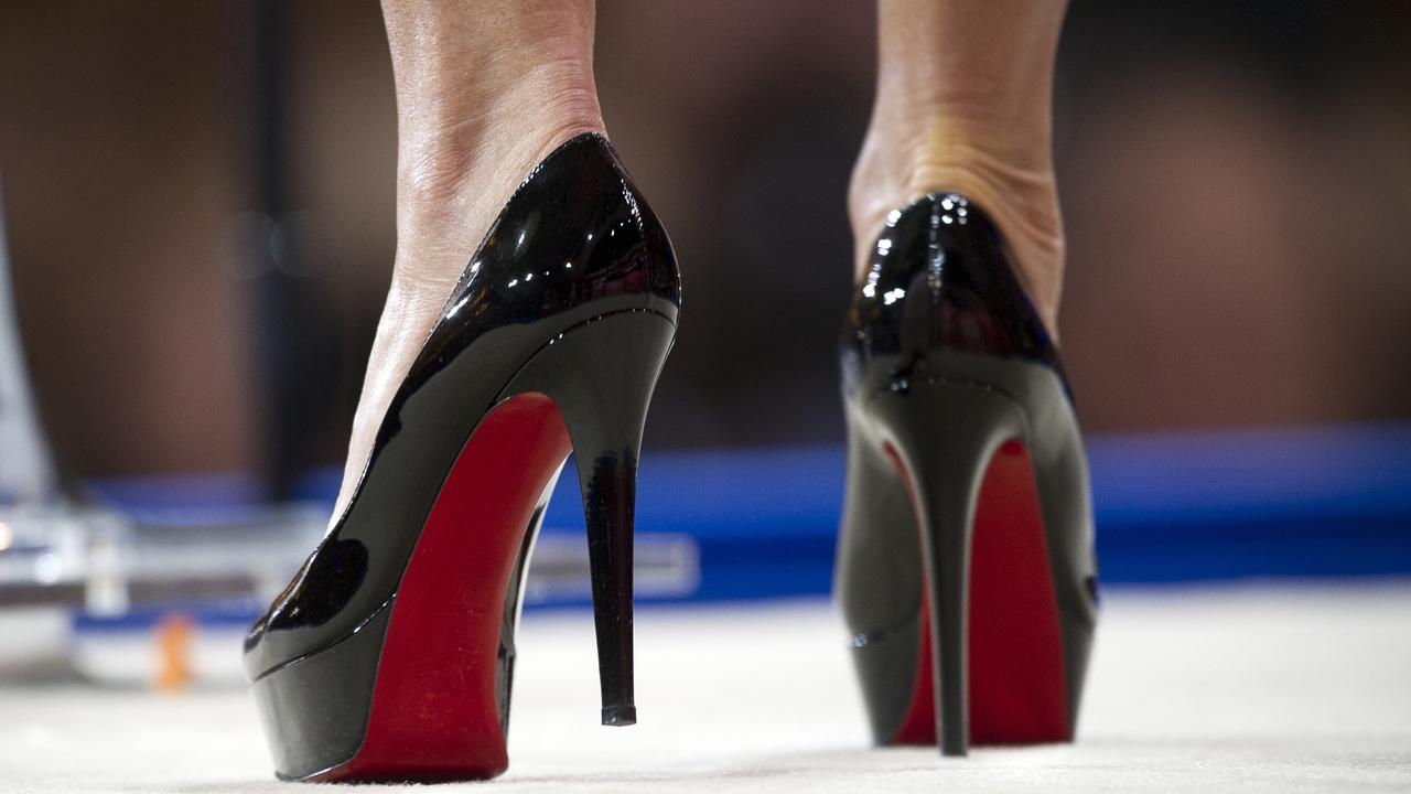 64073027c20 ... trademark battle over red soles. Louboutin s shoes found fame as the  high heels of choice for Carrie Bradshaw