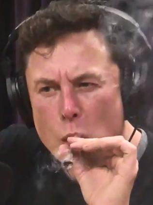 Elon Musk smoking 'pot' on the Joe Rogan Experience podcast in 2018.