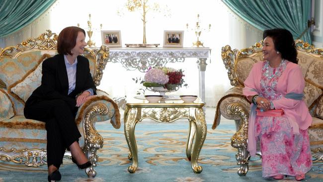 Former PM Julia Gillard talks to Rosmah Mansor on a visit to Malaysia.