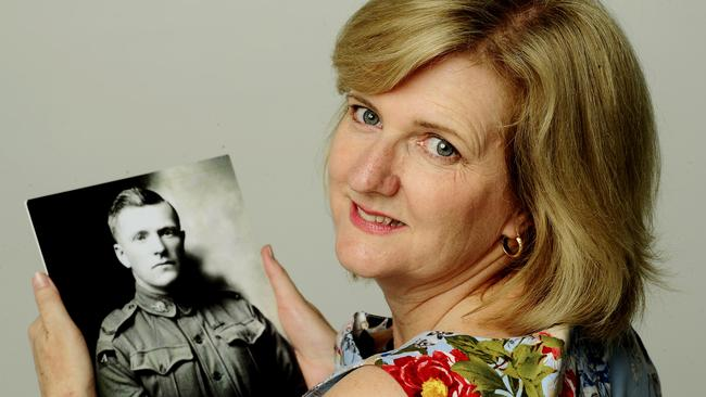 Fond memories to share ... Elizabeth Barwick holds a photo of her grandfather, Archie. Picture: John Appleyard.