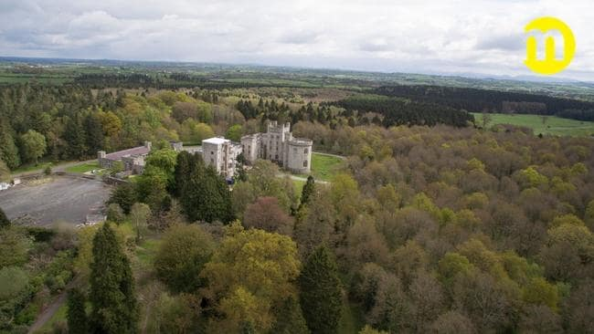 The castle has over 15 bedrooms and borders Gosford Forest Park. Picture: Maison Real Estate.