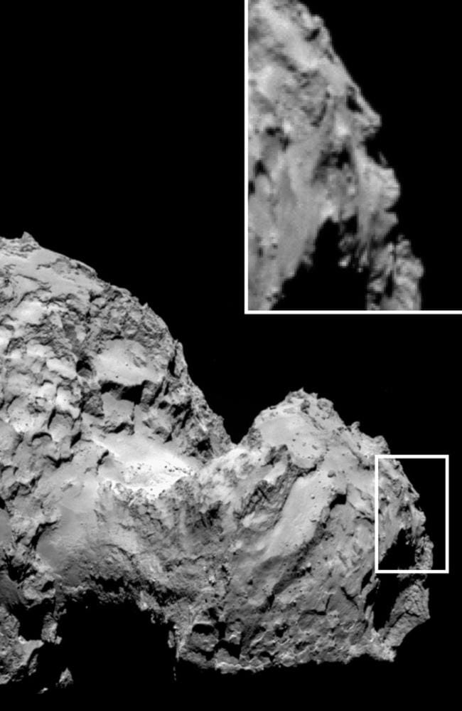 Mysterious face or rocky feature? This incredibly detailed close-up of Comet 67P/C-G appears to show a human face. The Rosetta Space probe is mapping its surface to find a place to land a science experiment package. Picture: ESA